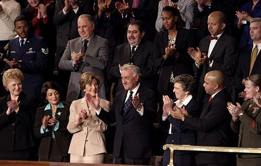 "Mrs. Bush applauds her special guest, Dr. Adnan Pachachi, President of the Iraqi Governing Council, during President Bush's State of the Union Address at the U.S. Capitol Tuesday, Jan. 20, 2004. ""Sir, America stands with you and the Iraqi people as you build a free and peaceful nation,"" said the President in his acknowledgement of Dr. Pachachi. White House photo by Paul Morse"