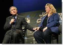 President George W. Bush introduces student Rebecca Albritton during a discussion on job training and the economy at Owens Community College in Perrysburg Township, Ohio, Wednesday, Jan. 21, 2004.  White House photo by Eric Draper