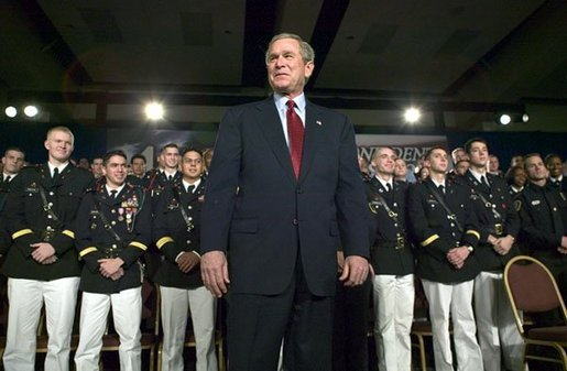 President George W. Bush stands on stage during his introduction before speaking on the war on terror at the Roswell Convention Center in Roswell, New Mexico, Thursday, Jan. 22, 2004. White House photo by Eric Draper