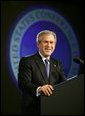 President George W. Bush reacts during his introduction at the United States Conference of Mayors in Washington, D.C., Friday, Jan. 23, 2004. White House photo by Eric Draper.