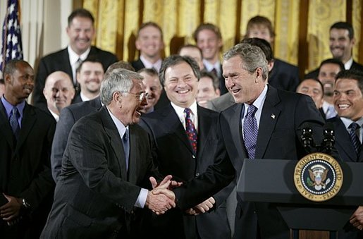 Shaking hands with manager Jack McKeon, President George W. Bush hosts a visit by the 2003 World Series Champions, the Florida Marlins, to the White House Friday, Jan. 23, 2004. White House photo by Paul Morse