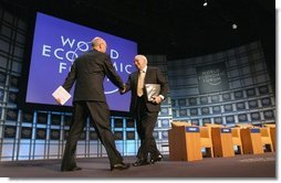 "Vice President Dick Cheney greets professor Klaus Schwab, founder and president of the World Economic Forum, before addressing more than 1,000 attendees at World Economic Forum in Davos, Switzerland Jan. 24, 2004. During his speech, Vice President Cheney said international cooperation is required to win the war on terror. ""We must meet the dangers together. Cooperation among our governments, and effective international institutions, are even more important today than they have been in the past.""  White House photo by David Bohrer"