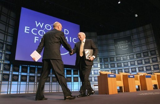 "Vice President Dick Cheney greets professor Klaus Schwab, founder and president of the World Economic Forum, before addressing more than 1,000 attendees at World Economic Forum in Davos, Switzerland Jan. 24, 2004. During his speech, Vice President Cheney said international cooperation is required to win the war on terror. ""We must meet the dangers together. Cooperation among our governments, and effective international institutions, are even more important today than they have been in the past."" White House photo by David Bohrer."