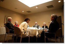 President George W. Bush meets with doctors and patients to talk about medical liability reform Baptist Health Medical Center in Little Rock, Ark., Monday, Jan. 26, 2004.  White House photo by Paul Morse