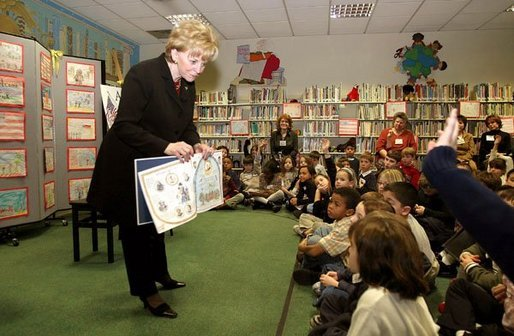 "Students at Vincenza Elementary School listen as Lynne Cheney reads her book ""America: A Patriotic Primer"" during her visit to Caserma Ederle in Vicenza, Italy, Jan. 27, 2004. White House photo by David Bohrer."