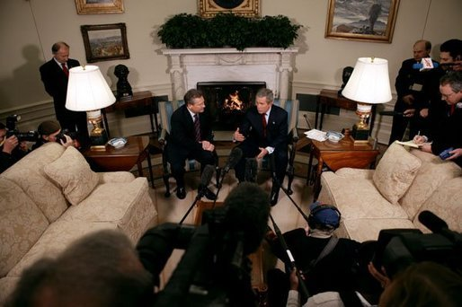 President George W. Bush and President Aleksander Kwasniewski talk with the press in the Oval Office Tuesday, Jan. 27, 2004. After their meeting, President Bush hosted a lunch for President Kwasniewski White House photo by Eric Draper.