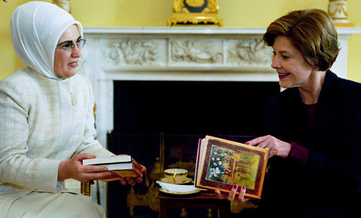 Laura Bush accepts books of poetry by Turkish poet Rumi presented by Emine Erdogan, wife of the Prime Minister of Turkey, during a coffee at the White House Thursday, Jan. 29, 2004. White House photo by Susan Sterner