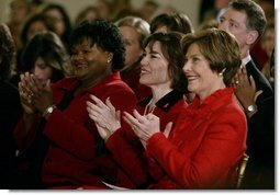 Laura Bush listsens with Assistant Secretary for Health (acting) Dr. Cristina Beato, center, and heart attack survivor Joyce Cullen, left, during White House ceremonies to launch American Heart Month. The event, part of the national Heart Truth campaign, was held to highlight the issue of heart disease as the number-one killer of women in the United States. Monday, Feb. 2, 2004.  White House photo by Susan Sterner