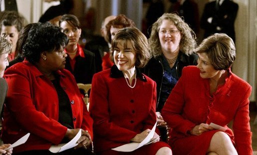 Laura Bush and Assistant Secretary for Health (acting) Dr. Cristina Beato, center, listen to heart attack survivor Joyce Cullen. Ms. Cullen spoke about her experiences as a survivor during a White House ceremony held as part of the national Heart Truth campaign to raise awareness of heart disease as the number-one killer of women in the United States. Monday, Feb. 2, 2004. White House photo by Susan Sterner