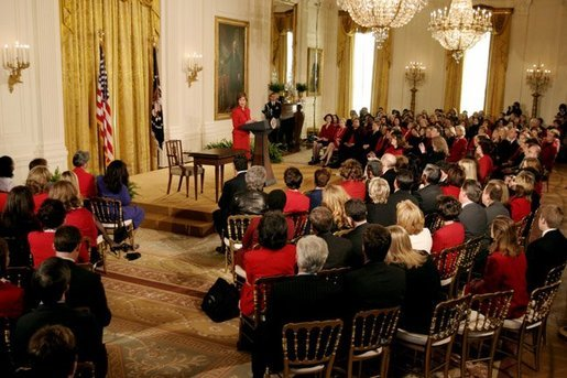 Laura Bush talks about the importance of educating women and doctors on the risks of heart disease and the basic preventive measures of exercise, a healthy diet, and regular medical screening during a Heart Truth campaign event at the White House Monday, Feb. 2, 2004. White House photo by Paul Morse