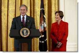 President George W. Bush and Laura Bush talk about heart disease as the number-one killer of all Americans during White House ceremonies to launch American Heart Month Monday, Feb. 2, 2004. The event, part of the national Heart Truth campaign, was held to highlight the issue of heart disease and women.  White House photo by Susan Sterner