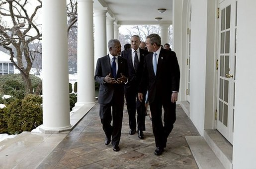 President George W. Bush and United Nations Secretary General Kofi Annan walk with Secretary of State Colin Powell along the colonnade in the Rose Garden at the White House Tuesday, Feb. 3, 2004. White House photo by Paul Morse