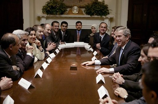 President George W. Bush meets with 25 Iraqi Fulbright Scholars in the Roosevelt Room Tuesday, Feb. 3, 2004. Reestablished in October of 2003, the Fulbright Program offers its scholarship recipients the opportunity to study at American universities. White House photo by Paul Morse.