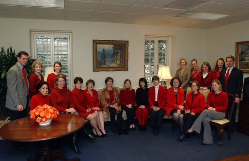 Supporting The Heart Truth campaign, Laura Bush and her staff celebrate the first annual National Wear Red Day in support of women's heart disease awareness, Friday, Feb. 6, 2004. The color red is worn to symbolize the commitment to fight heart disease and to educate every American about the power of prevention. White House photo by Tina Hager