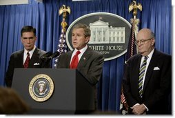 "President George W. Bush holds a press briefing at the White House Friday, Feb. 6, 2004. ""Today, by executive order, I am creating an independent commission, chaired by Governor and former Senator Chuck Robb (left), Judge Laurence Silberman (right), to look at American intelligence capabilities, especially our intelligence about weapons of mass destruction,"" said the President.   White House photo by Paul Morse"