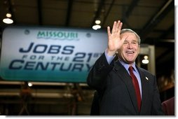 President George W. Bush acknowledges the audience shortly before participating in a conversation on the economy at SRC Automotive in Springfield, Mo., Monday, Feb. 9, 2004.  White House photo by Eric Draper