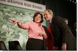 President George W. Bush talks with student Cari Aftosmes after a conversation on the Economy and the Jobs for the 21st Century Initiative at Central Dauphin High School in Harrisburg, PA.  White House photo by Paul Morse