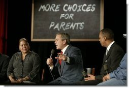 President George W. Bush talks about parental options and school choice at Archbishop Carroll High School in Washington, D.C., Friday, Feb. 13, 2004.  White House photo by Paul Morse