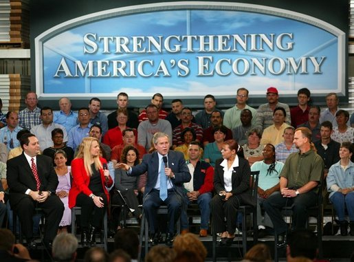 President George W. Bush leads the on stage discussion during a conversation on the economy with employees at Nu-Air Manufacturing Company in Tampa, Florida, Monday, Feb. 16, 2004. White House photo by Eric Draper