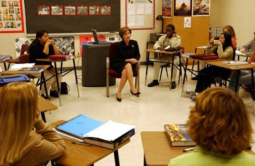 "Laura Bush talks with history students at Bentonville High School in Bentonville, Ark., Tuesday, Feb. 17, 2004. ""We'll need more than 2 million new teachers in America's classrooms in the next decade,"" said Mrs. Bush in her remarks about education. ""We want teachers with diverse academic backgrounds who will commit to teaching in urban or rural public schools, where teachers are desperately needed."" White House photo by Tina Hager"