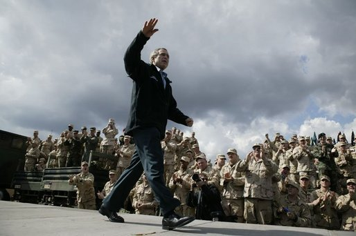 "President George W. Bush receives cheers before giving remarks to military personnel at Fort Polk, La., Tuesday, Feb. 17, 2004. ""In the war, America depends on our military to meet the dangers abroad and to keep our country safe,"" said the President. ""The American people appreciate this sacrifice. And our government owes you more than gratitude."" White House photo by Paul Morse."