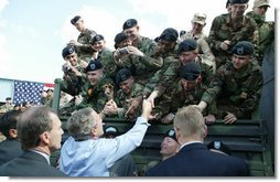 President George W. Bush greets soldiers after giving remarks to military personnel Fort Polk, La., Tuesday, Feb. 17, 2004.  White House photo by Paul Morse