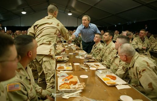 President George W. Bush greets national guardsmen as he joins them for lunch at Fort Polk, La., Tuesday, Feb. 17, 2004. White House photo by Paul Morse.