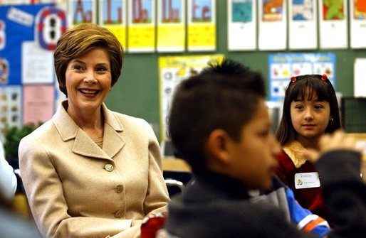 "Laura Bush participates in a reading lab with third and fourth graders at Limerick Elementary school in Los Angeles, California, Wednesday, February 18, 2004. ""We know that if children don't learn to read by the end of the 3rd grade or 4th grade, their chances for learning to read decrease every year, and by the time they get to high school they're often the ones who drop out because of frustration that they -- over not being able to read,"" said Mrs. Bush during her visit to Limerick Elementary. White House photo by Tina Hager"