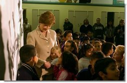 Laura Bush is greeted by students at Limerick Elementary School in Los Angeles, California, Wednesday, February 18, 2004.  White House photo by Tina Hager