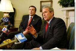 President George W. Bush answers questions from the press after meeting with the president of Georgia Mikhail Saakashvili in the Oval Office on February 25, 2004.  White House photo by Paul Morse
