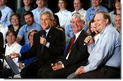 President George W. Bush participates in a conversation on the economy with employees of ISCO Industries in Louisville, Ky., Thursday, Feb. 26, 2004.  White House photo by Tina Hager