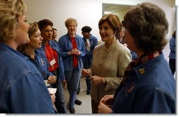"Laura Bush visits with military wives at the Fort Hood Women's Conference in Fort Hood, Texas, Friday, March 5, 2004. ""Today, we celebrate you, the women in the United States military who are married to military officers or enlisted men, or who are military women, themselves. And we celebrate all that you do to make our military the strongest in the world,"" said Mrs Bush in her remarks to the conference.  White House photo by Tina Hager"