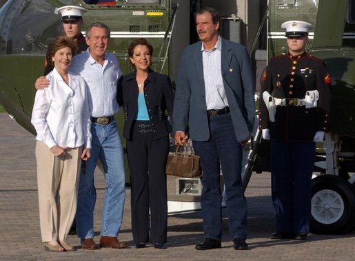 President George W. Bush and Laura Bush welcome President Vicente Fox of Mexico and Mrs. Martha Fox to their Ranch in Crawford, Texas. Friday, March 5, 2004. White House photo by Tina Hager.