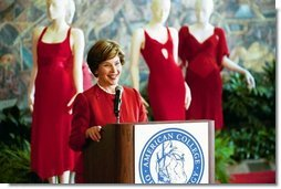 Laura Bush makes remarks during her tour of the Red Dress Project exhibit at the New Orleans Convention Center March 8, 2004.  White House photo by Tina Hager