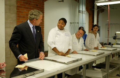Attending the Women's Entrepreneurship in the 21st Century Forum, President George W. Bush tours Thermagon, Inc., in Cleveland, Ohio, Wednesday, March 10, 2004. The company was founded by entrepeneur Carol Latham in 1992. White House photo by Paul Morse