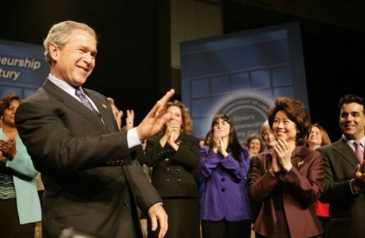 President George W. Bush reacts to the applause of the crowd before speaking at the Women's Entrepreneurship in the 21st Century Forum in Cleveland, Ohio, Wednesday, March 10, 2004. White House photo by Paul Morse