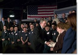 President George W. Bush greets employees of USA Industries, after a conversation on the economy and job training in Bay Shore, New York, Thursday, March 11, 2004.  White House photo by Eric Draper