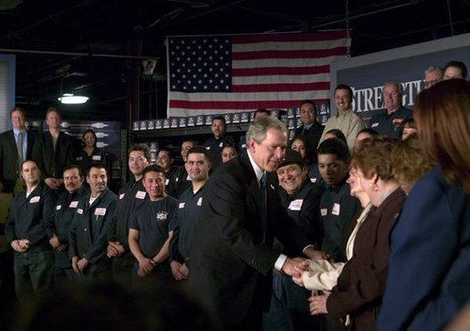 President George W. Bush greets employees of USA Industries, after a conversation on the economy and job training in Bay Shore, New York, Thursday, March 11, 2004. White House photo by Eric Draper.