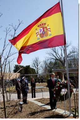 Honoring the victims of terrorist bombings in Spain, President George W. Bush bows his head in silence during a wreath-laying ceremony at the Spanish ambassadors' residence in Washington, D.C., Friday, March 12, 2004.   White House photo by Paul Morse