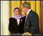 President George W. Bush greets Dr. Raja Habib Khuzai of the Iraqi Governing Council after delivering remarks on Women's Human Rights in the East Room of the White House Fridy, March 12, 2004. White House photo by Paul Morse.