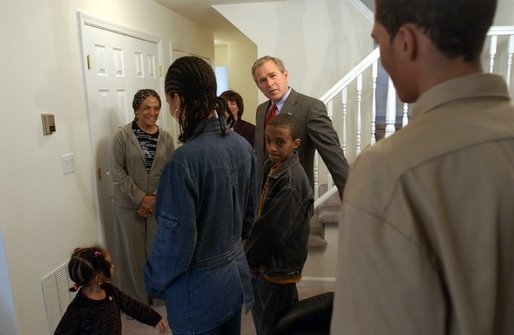 President George W. Bush visits with Pearl Cerdan and her four children in Ardmore, Pa., Monday, March 15, 2004. Ms. Cerdan, a first-time homebuyer, moved into her Spring Avenue Development home in December of 2003. White House photo by Tina Hager