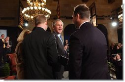 President George W. Bush greets participates in the President's conversation about health access at the U.S. Chamber of Commerce Tuesday, March 16, 2004.  White House photo by Tina Hager