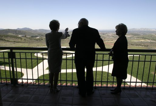 Looking over a replica of the White House South Lawn, former First Lady Nancy Reagan leads Vice President Dick Cheney and Mrs. Lynne Cheney on a tour of the Ronald Reagan Presidential Library and Museum in Simi Valley, Calif., Wednesday, March 17, 2004. White House photo by David Bohrer.