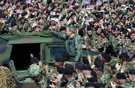 "President George W. Bush and Laura Bush are welcomed by military personnel, including the 101st Airborne Division, at Fort Campbell, Ky., Thursday, March 18, 2004. ""Fort Campbell was the first army post I visited in the weeks after our country was attacked,"" said the President during his remarks. Continuing his remarks, the President said, ""Since we last met, you deployed over 5,000 vehicles, 254 aircraft, and 18,000 soldiers in Kuwait, in the fastest deployment in the history of the 101st."" White House photo by Tina Hager"