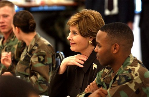 President George W. Bush and Laura Bush have lunch with soldiers in Fort Campbell, Kentucky. Thursday, March 18, 2004. White House photo by Tina Hager.