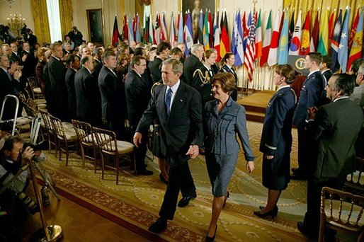 President George W. Bush and Laura Bush exit the East Room following the President's remarks commemorating the one-year anniversary of operation Iraqi Freedom and the efforts of his administration and 91 nations to ensure peace and stability in Iraq, Afghanistan and the Greater Middle East Friday, March 19, 2004. White House photo by Susan Sterner.