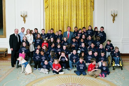 President George W. Bush poses for a photograph with the Children's Miracle Network Champions Across America Representatives in the East Room of the White House Monday, March 22, 2004. The Champions are children who have battled a wide range of challenges, including birth defects, cancer and life-threatening injuries. They now serve as ambassadors for the network. White House photo by Tina Hager.