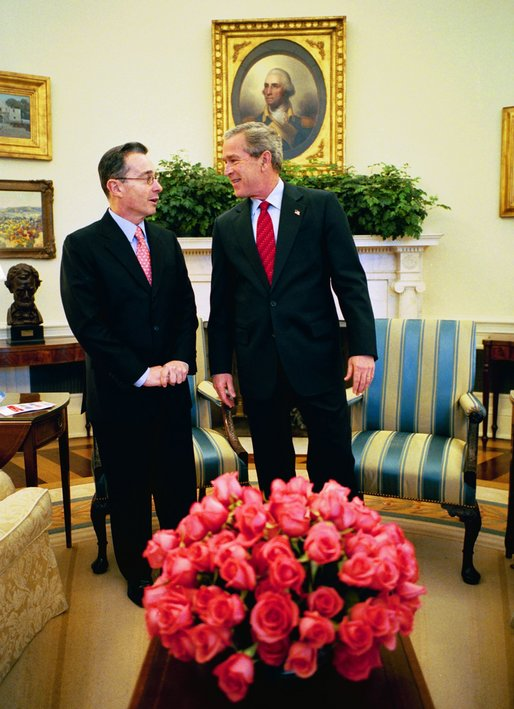 President George W. Bush meets with Colombian President Alvaro Uribe in the Oval Office Tuesday, March 23, 2004. White House photo by Eric Draper