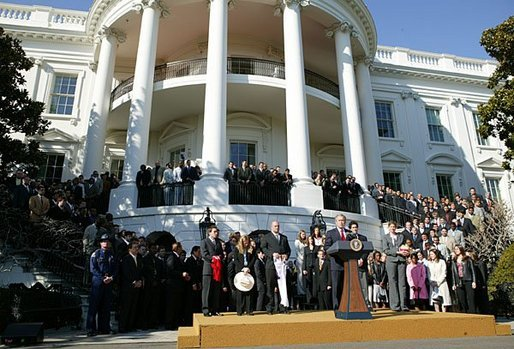 President George W. Bush hosts a visit by the 2003 Fall NCAA Championship teams on the South Lawn March 23, 2004. In attendance were the University of Southern California's football and women's volleyball teams, the University of North Carolina women's soccer team, Louisiana State University football team and Indiana University men's soccer team. White House photo by Paul Morse.