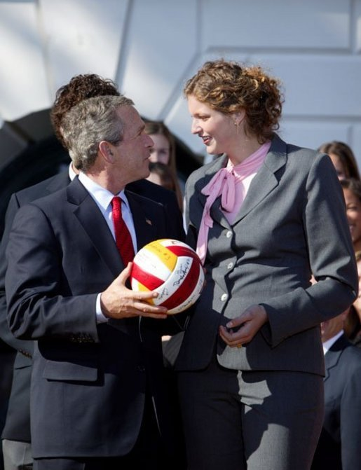 President George W. Bush greets Emily Adams of University of Southern California's women's volleyball team during a visit by the 2003 Fall NCAA Championship teams on the South Lawn March 23, 2004. In attendance were the University of Southern California's football and women's volleyball teams, the University of North Carolina women's soccer team, Louisiana State University football team and Indiana University men's soccer team. White House photo by Paul Morse.